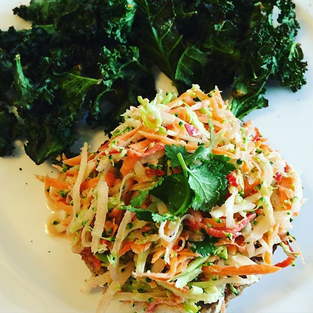 Turkey burger hidden under broccoli & carrot slaw with a side of chili pepper kale chips #paleo #getinmybelly #cleaneating #eatrealfood #kmtherapyandwellness