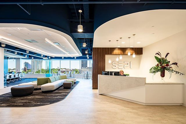 Here's a look at the beautifully designed SEPI offices at the new One Glenwood building.  This place has lots of great features such as a moss ceiling installation, warm wood elements and a folding glass wall that opens up the main conference room and lobby.  The views of downtown aren't too bad either 😉. Interiors by @phillipsarchitecturepa  #workplacedesign #officeinteriors