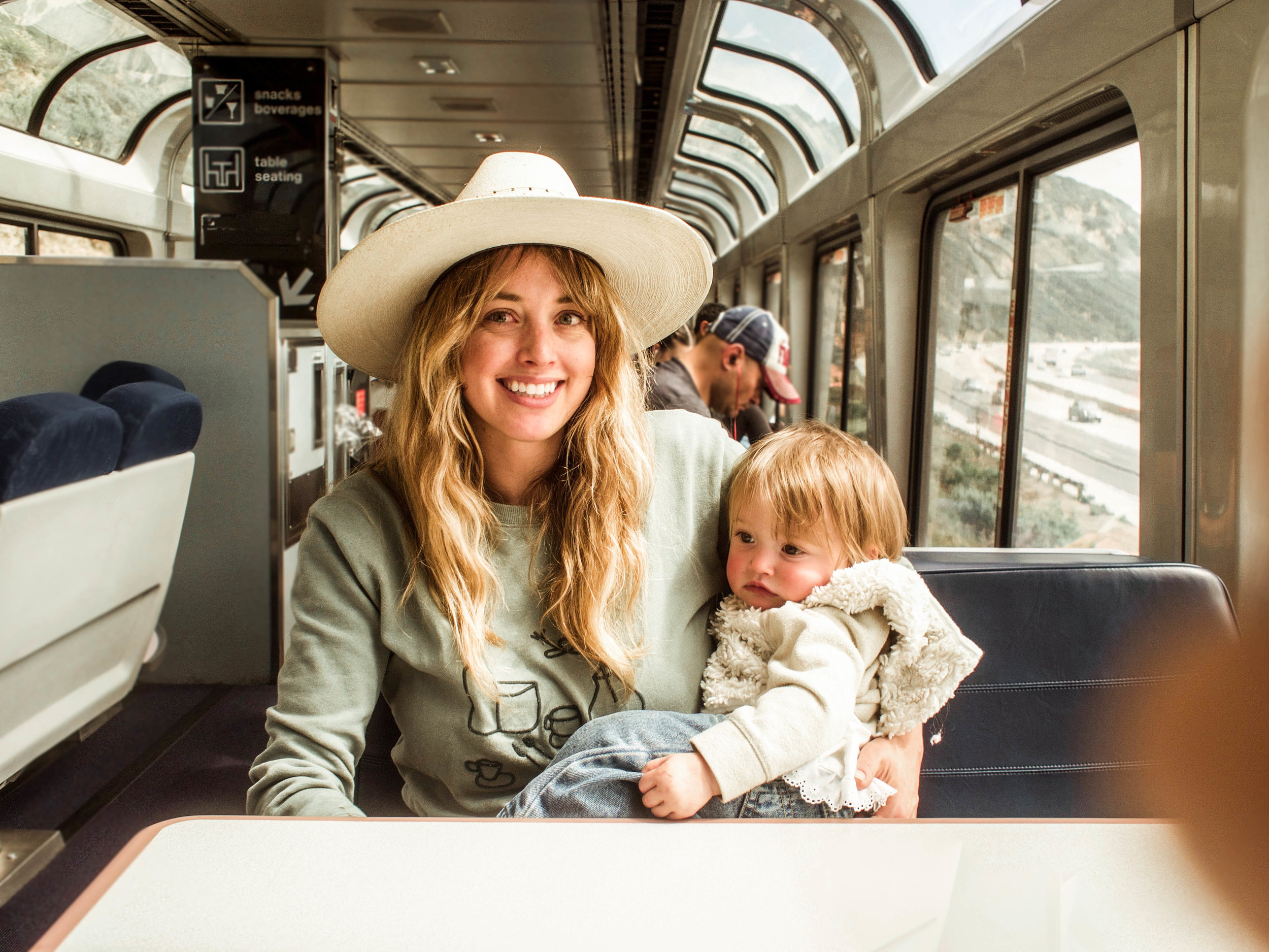 momma and babe on a train