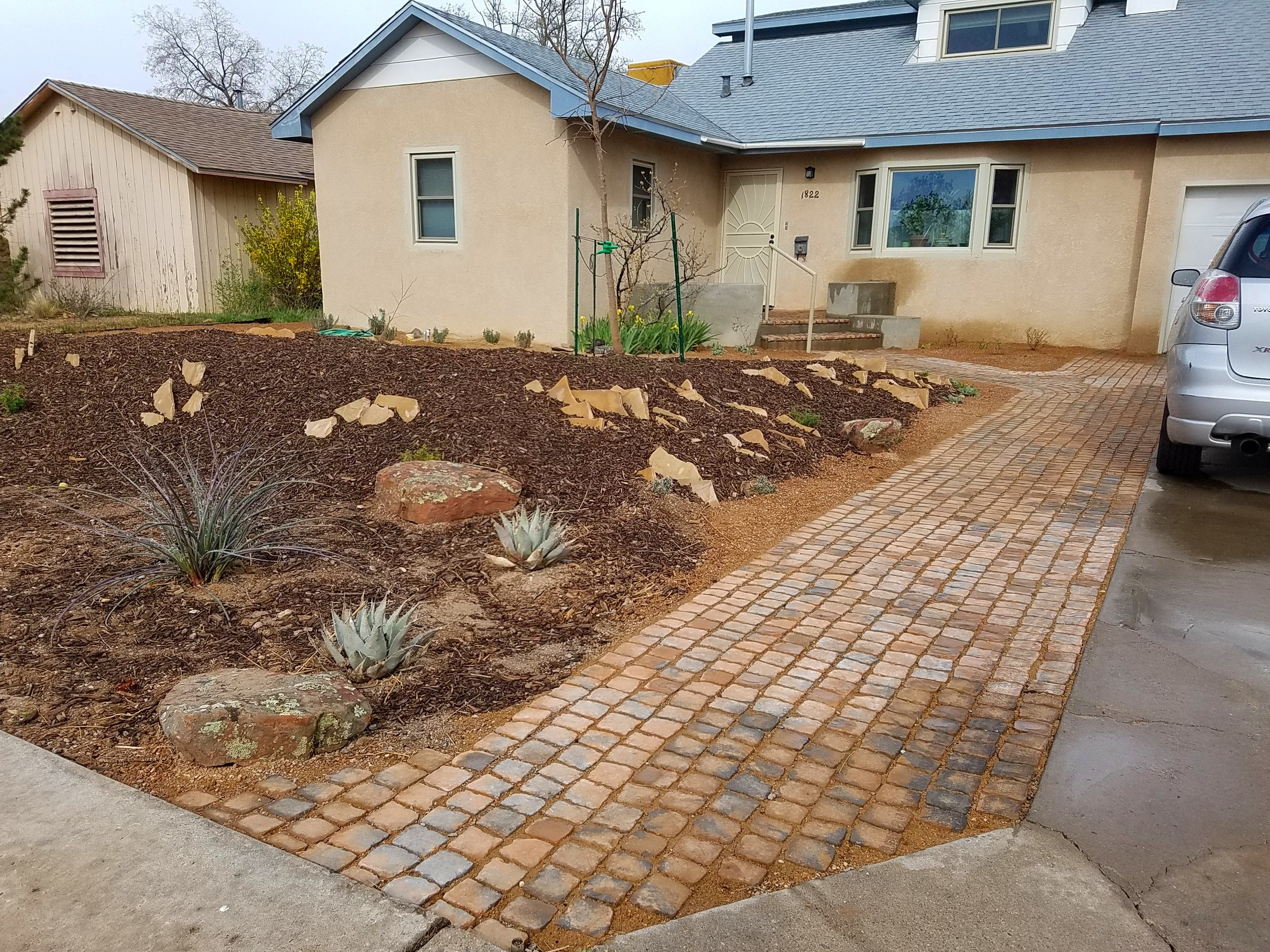Another completed #landscape designed by a local landscape architect. The #flagstone #rock garden was meant to emulate a feature seen in the Denver #botanical #gardens. These permeable #paver #walkways allow water through to tree roots and make a durable, showy surface.  #southwesthorticulture #landscaping #design #landscapedesign