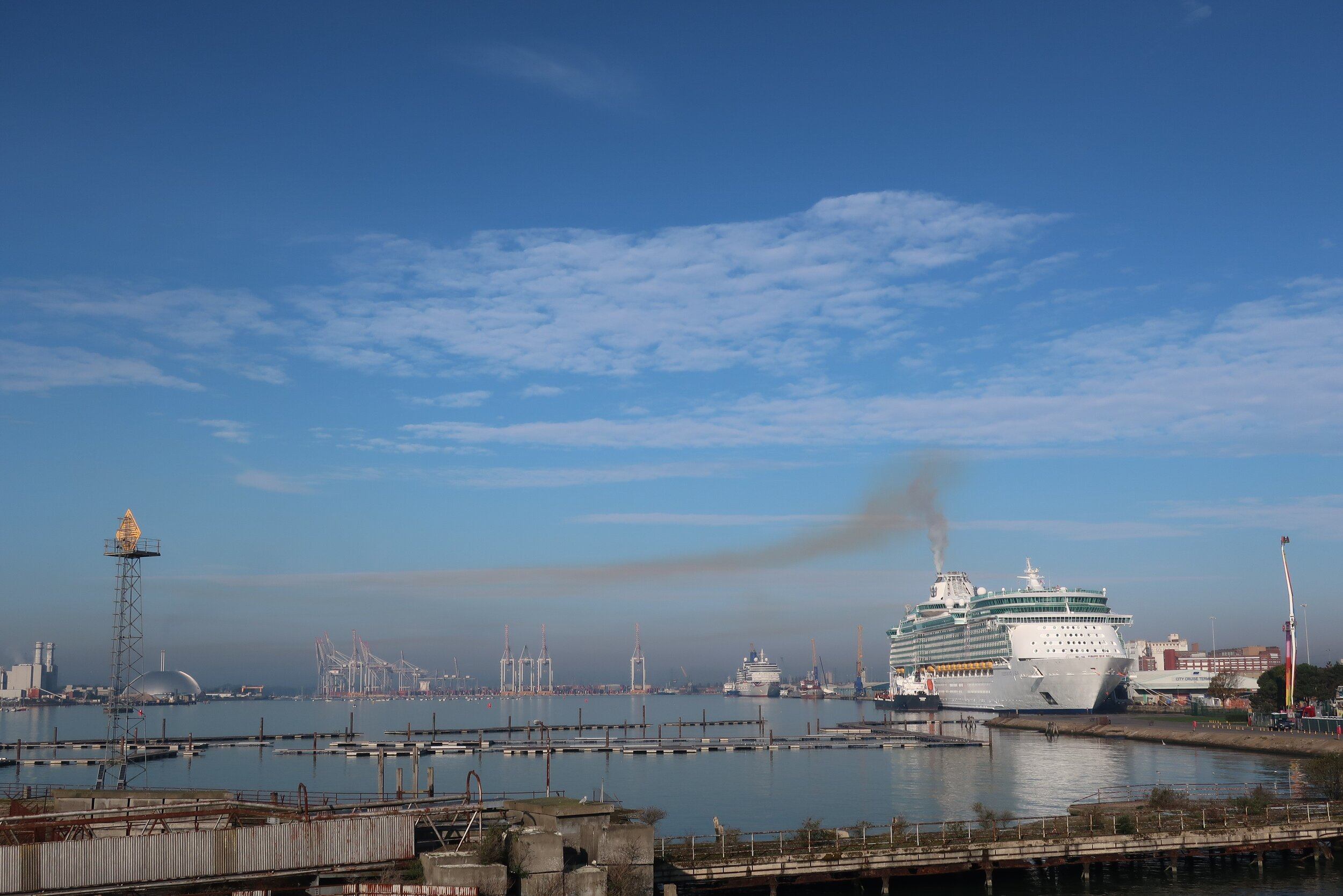 Photo showing the smoke plume from a cruise ship in dock in Southampton. The city has a diverse series of pollution sources that make mitigation a challenge that can be solved by the technical innovation offered by this project.