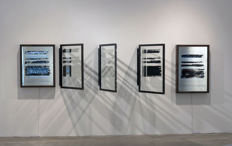 A Book and A Medal II (Unredacted)  (2014 - 2015) by Edgar Arceneaux Seven parts, silver, painting on mirrored glass, handcrafted steel frame and light boxes 41.50 in H x 160 in W x 4.50 in Photo by Robert Wedemeyer, Courtesy of the artist and Susanne Vielmetter Los Angeles Projects  Image courtesy of MIT List Visual Arts Center