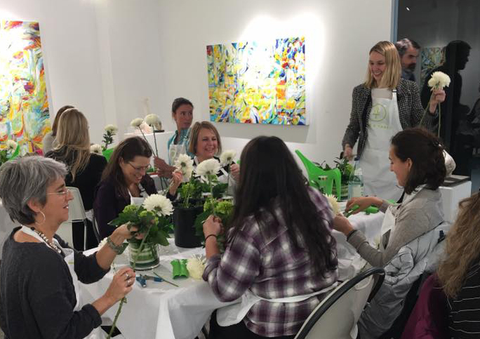 Alice leading a flower arranging class at Abigail Ogilvy Gallery