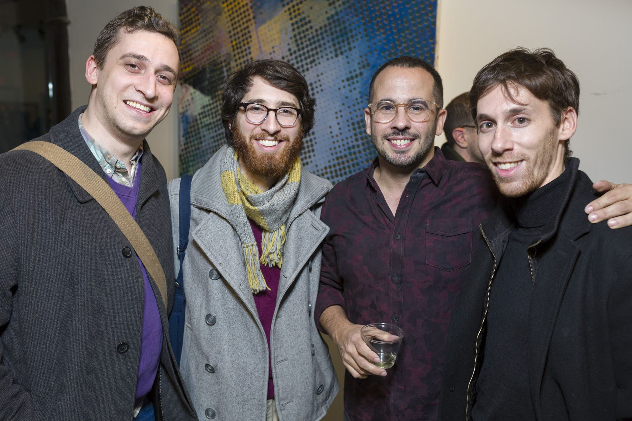 A lively crowd at A R E A opening night, including Gallery Director, David Guerra (2nd from right), image courtesy of  A R E A Gallery Facebook