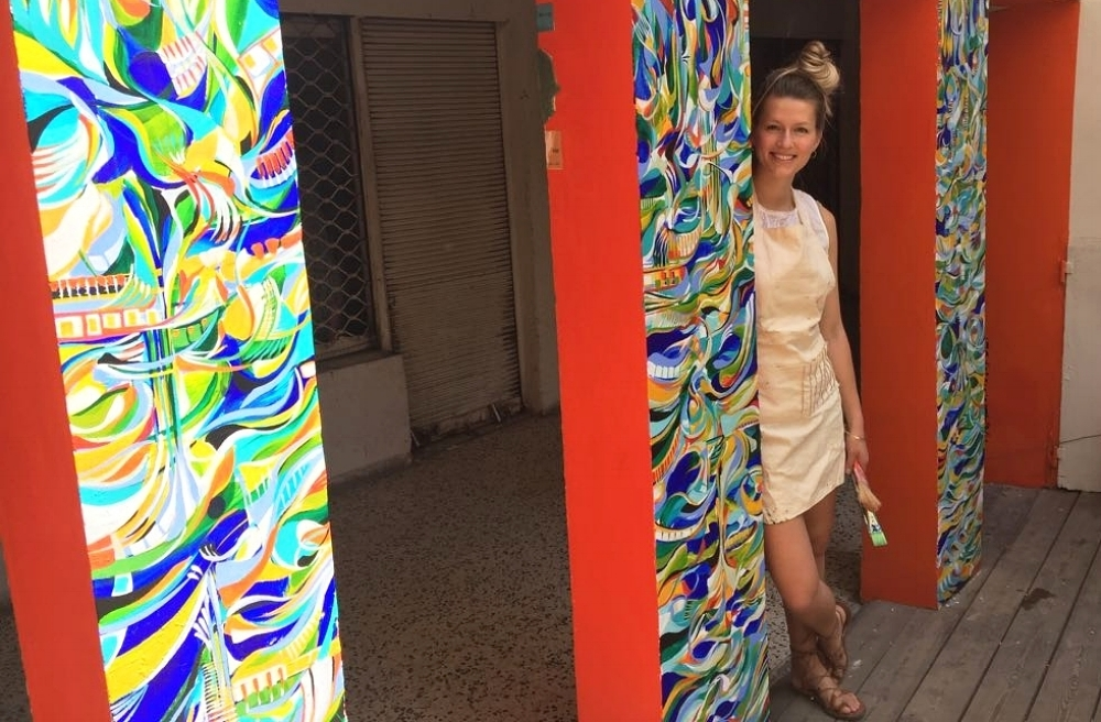 Natalia Wróbel with her mural at the Rena House, in Tel Aviv, Israel, image courtesy of the artist