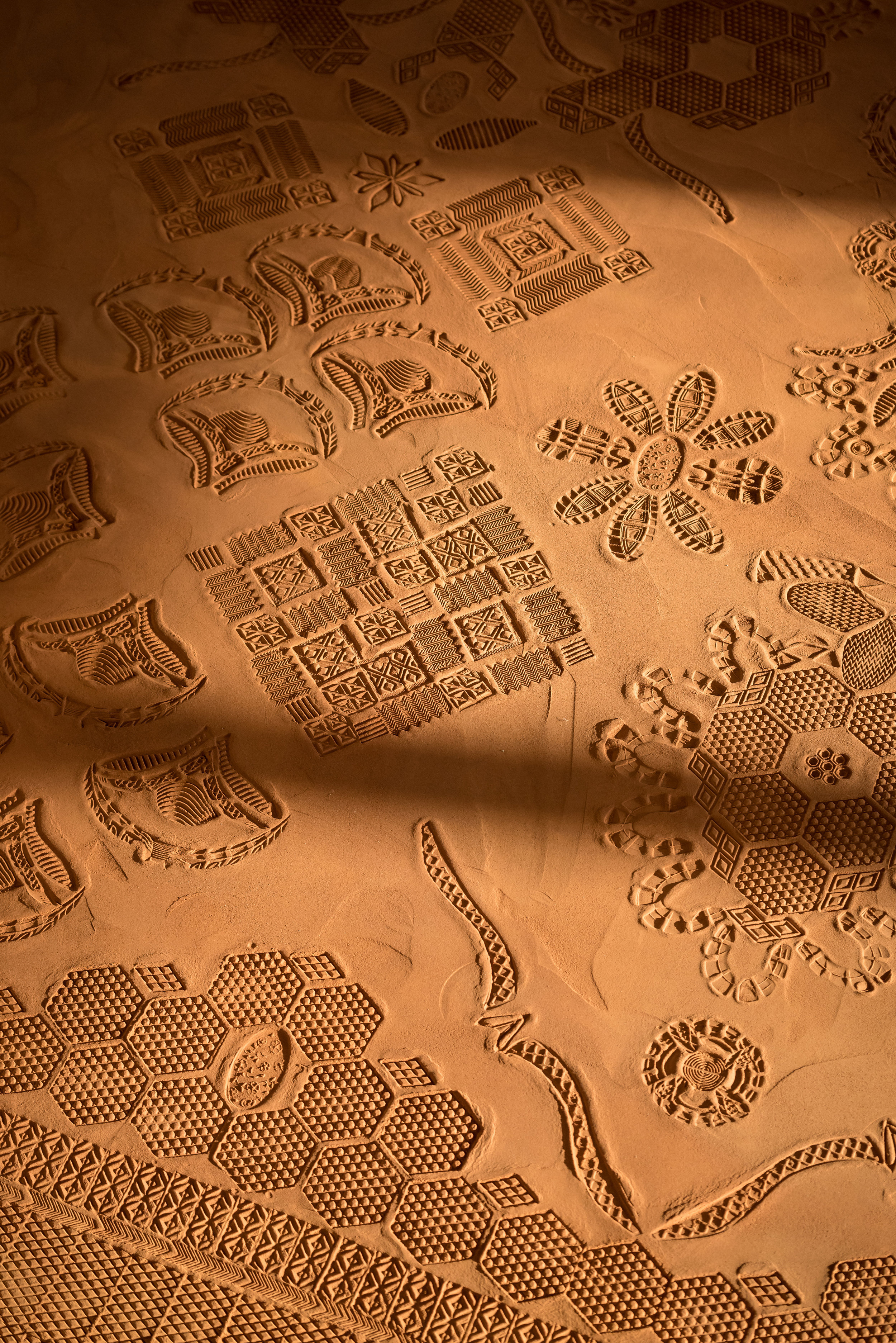 Detail of previous installation of  Red Dirt Rug . Photo by: Mark Andrus