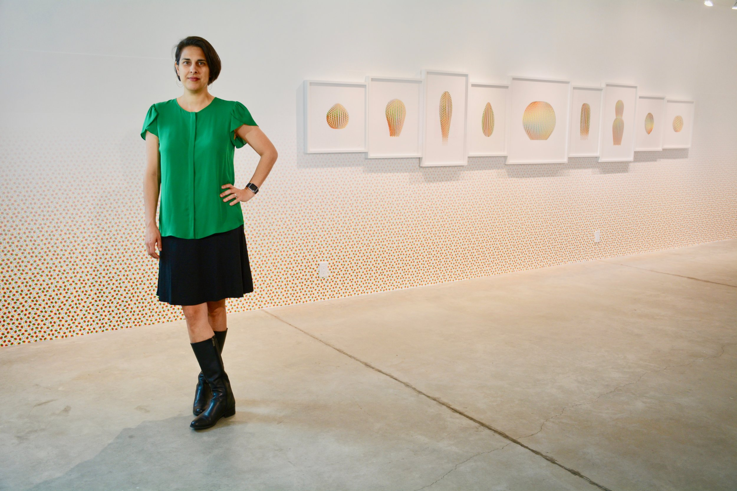 Cassandra C. Jones in front of her installation, Forever Temporary. Photo by: David Guerra