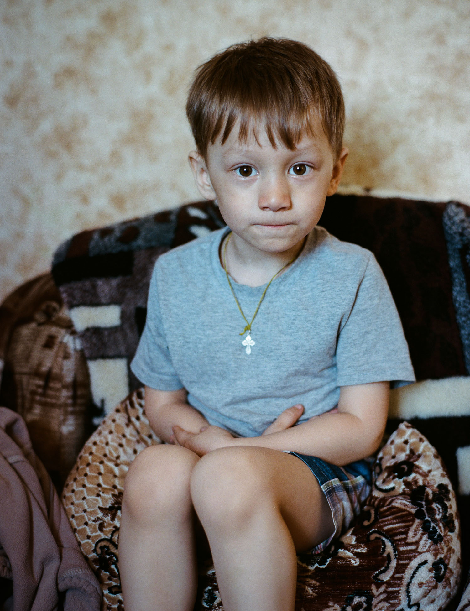 Nikolay's son is preparing to tell us a Poem which he learned for us. Photo: Contax 645 + Kodak