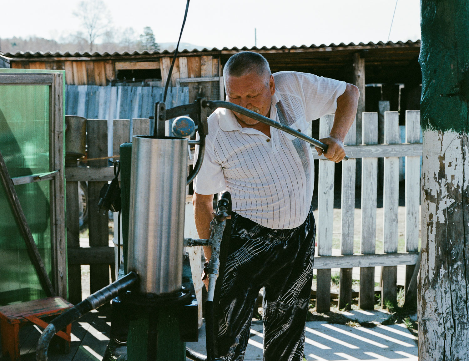 Getting fresh water from the well. Photo: Contax 645 + Kodak