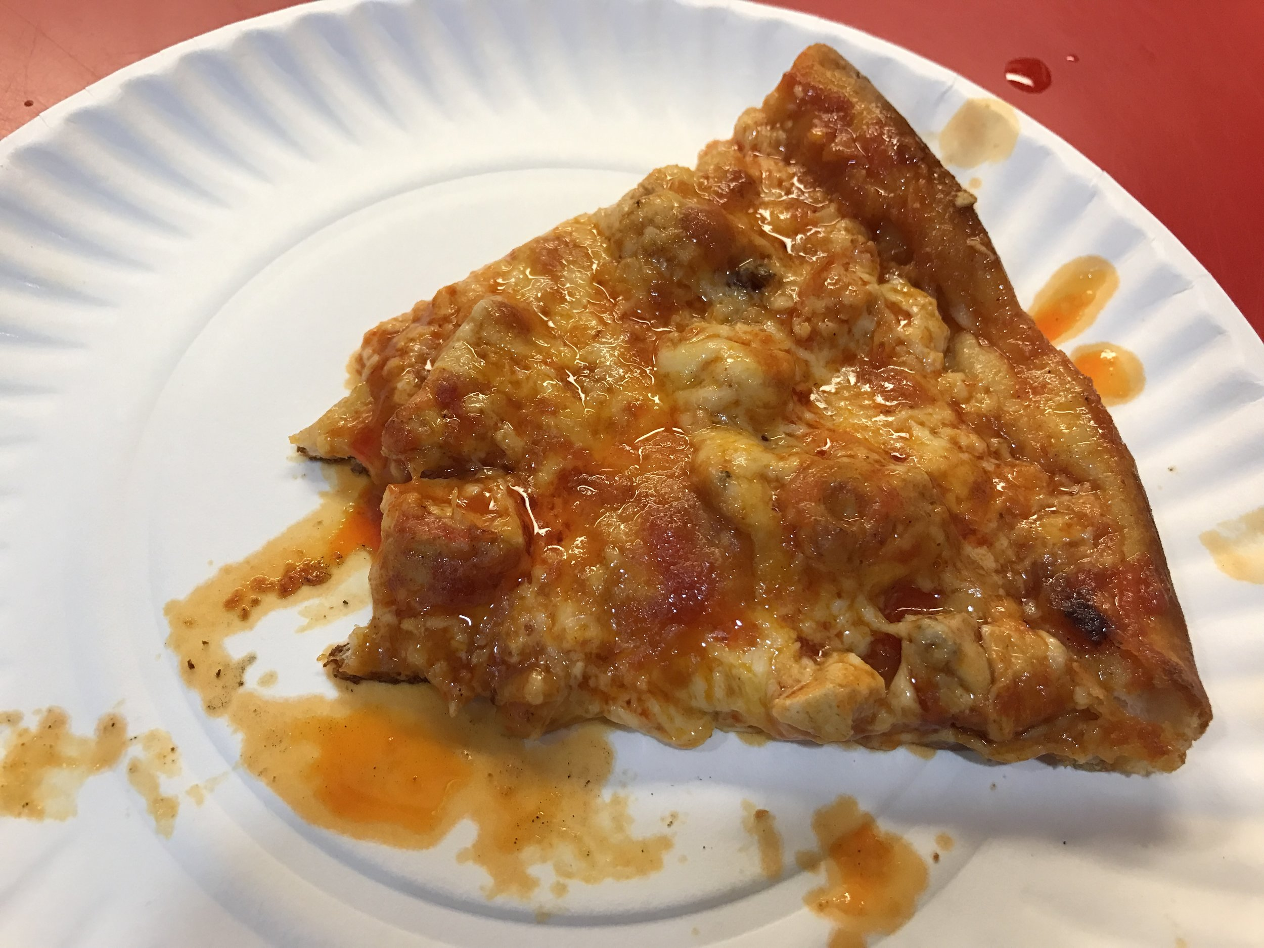 Here is a simple, sloppy slice of Graziano's buffalo chicken pizza.