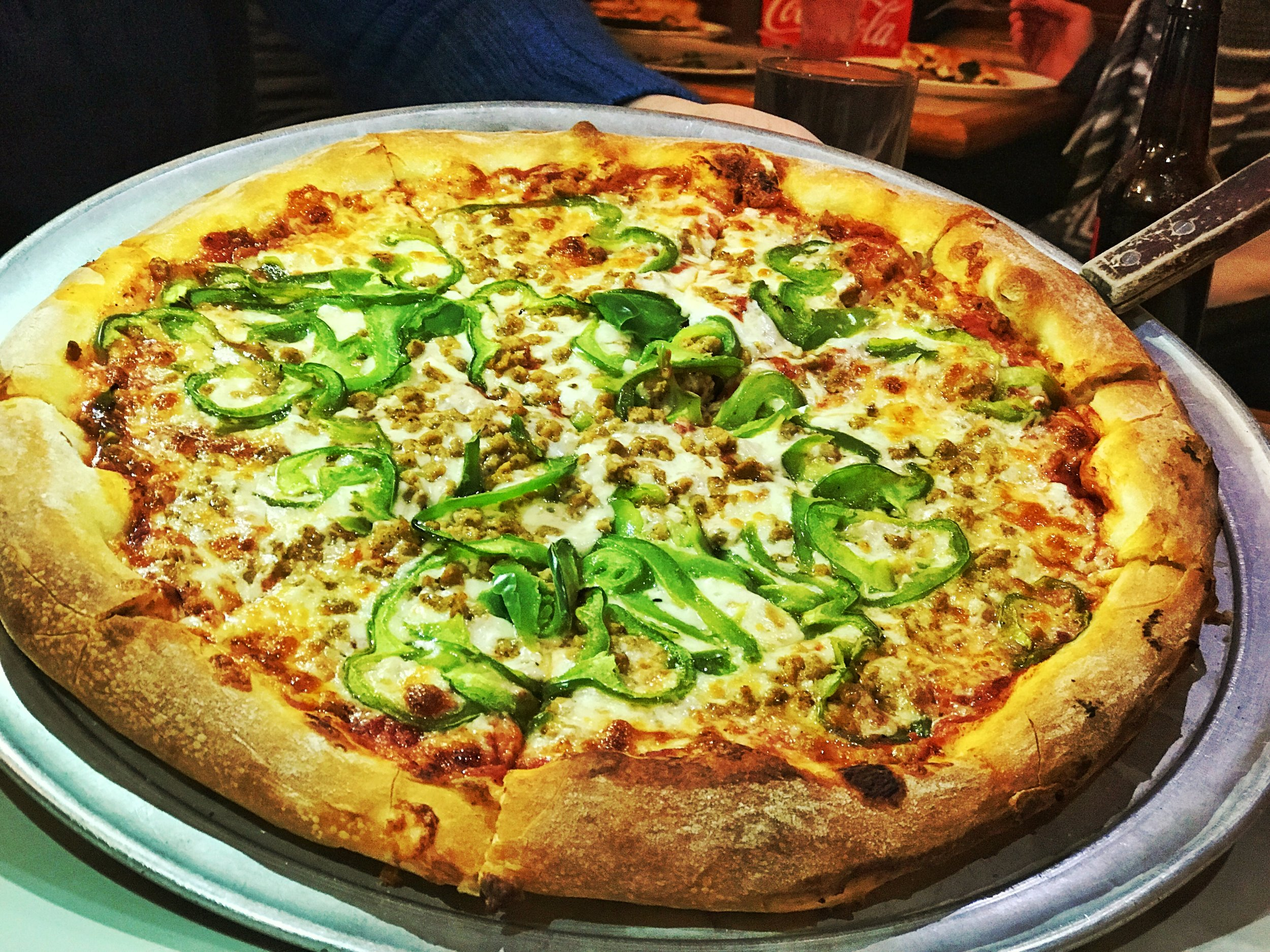 The classic sausage and green peppers pizza. This pizza was perfectly cooked, sturdy, and toppings evenly spread out.