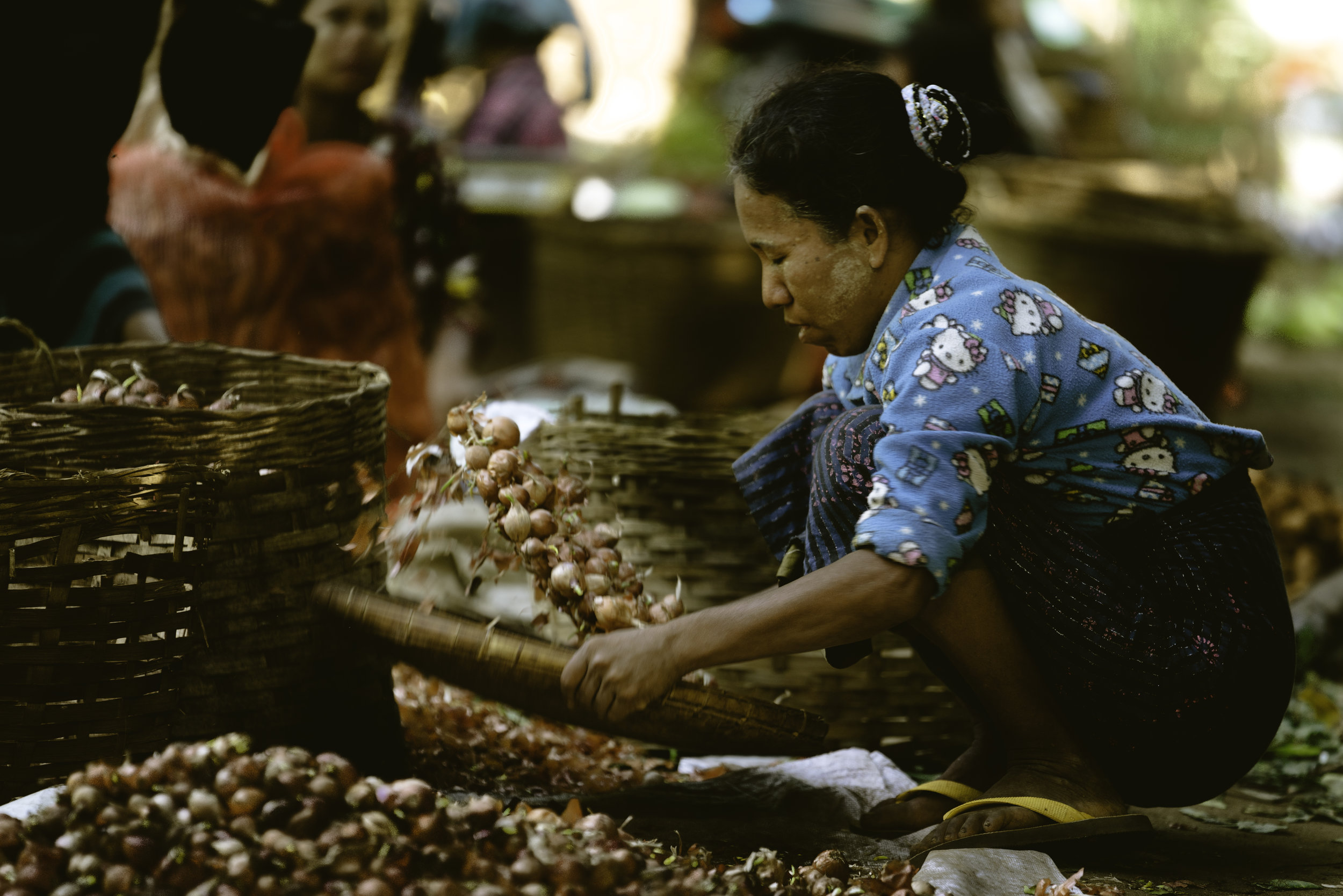 People of Bagan  A local vendor preparing red onions for sale.