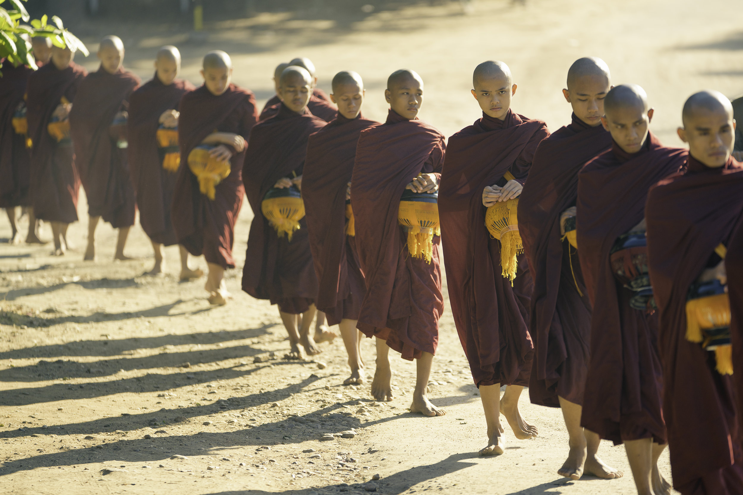 Monks accepting alms in the morning.