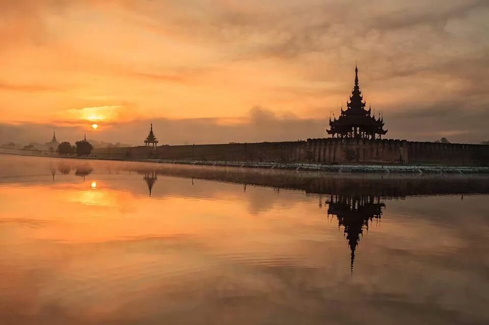 Sunset at the Mandalay Grand Palace  Mandalay palace is surrounded by a moat and creates an awesome reflection during sunset or sunrise.