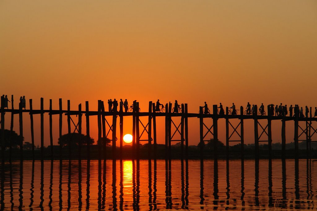 U Bein Bridge  The world's longest wooden bridge built in 1850, U Bein Bridge. Walkable, and Bikeable. Worth spending an evening for sunset.