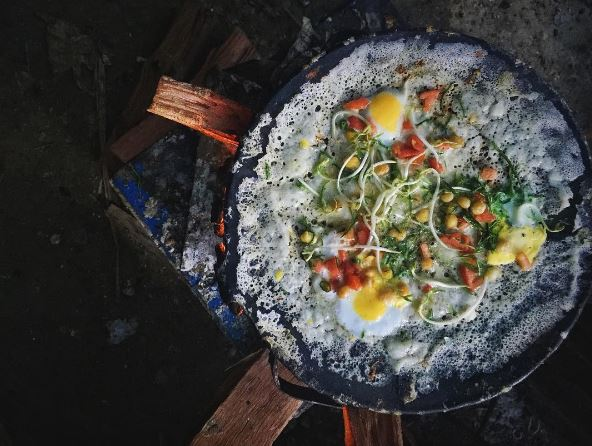 Savory Pancake (Yay Mont)  A traditional snack that is popular on the street made of rice flour, boiled egg, and assorted vegetables.    (photo credit to @  limeandcilantro  )