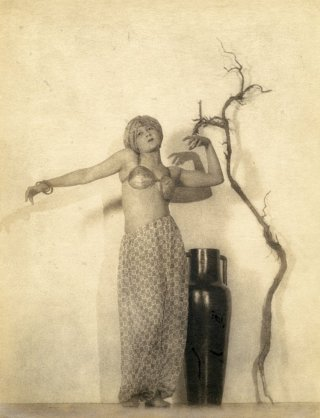 William Mortensen's  Rubaiyat of Omar Khayyam  is a pictorialist interpretation of a scene from the film by Ferdinand Pinney Earle, depicting the popular book of moral allegory by Omar Khayyam. Mortensen was a successful Hollywood photographer who used stage lighting for dramatic enactments of scenes which predated the birth of photography in 1839.
