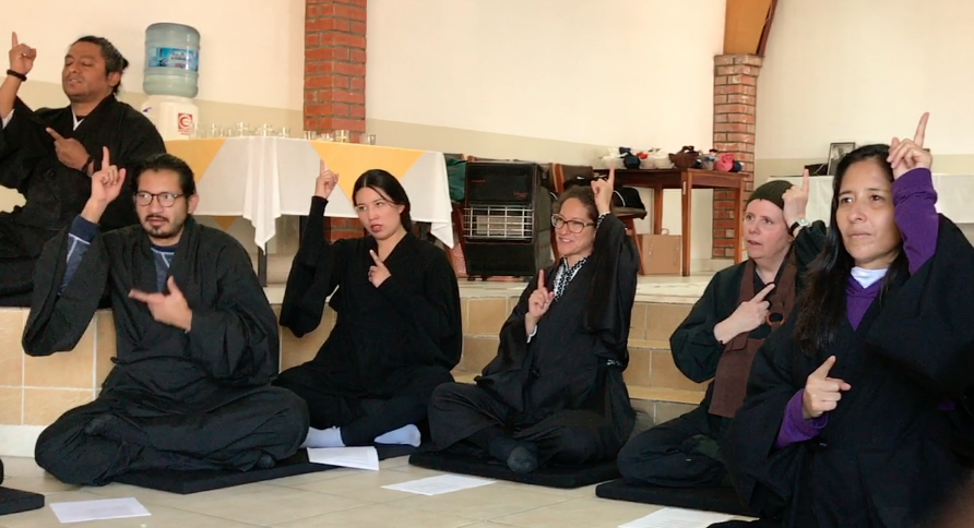 "A group including Bolivians and Myoko Sensei sign ""understanding"" of mind and heart."