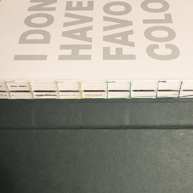 Hella Jongerius' book about Vitra colors and materials is appropriately bound with a rainbow of thread colors. Of course I'd collect such a book.