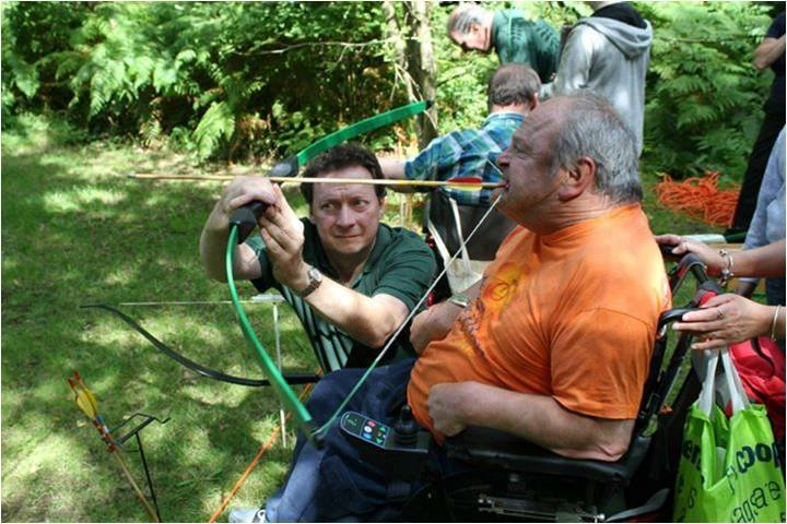 Camper, Clive Bailey, fires a BOW and Arrow with his teeth during the archery activity.