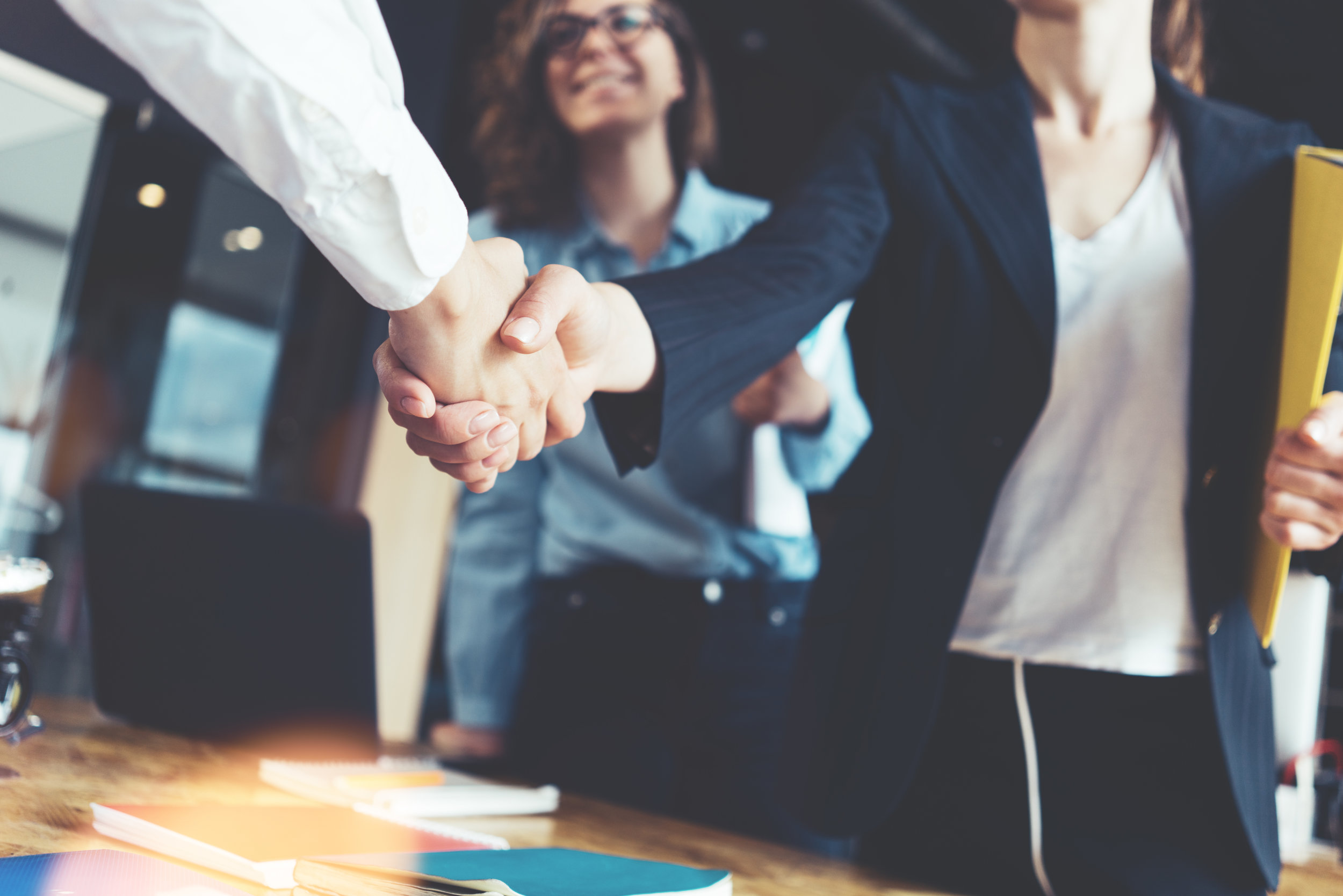 oung business people shaking hands in the office. Finishing successful meeting. AdobeStock_158504099.jpeg