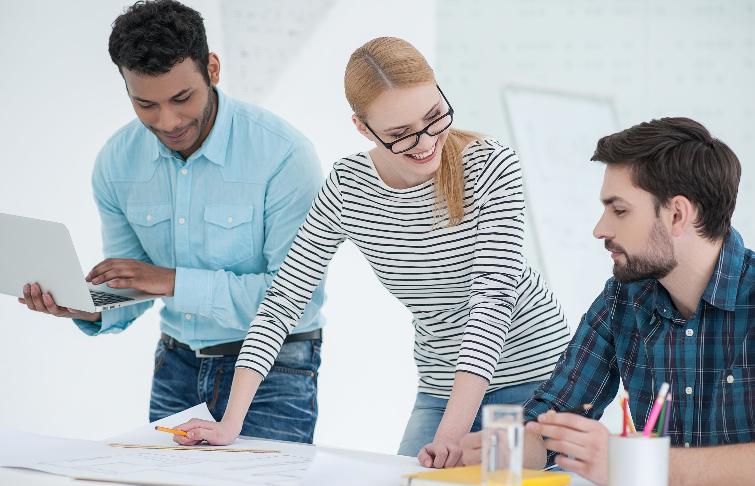 Group of architects discussing plans in modern office AdobeStock_124394963.jpeg