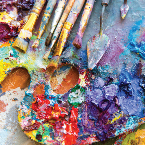 A palette of messy paints show us the beauty of a good mess.