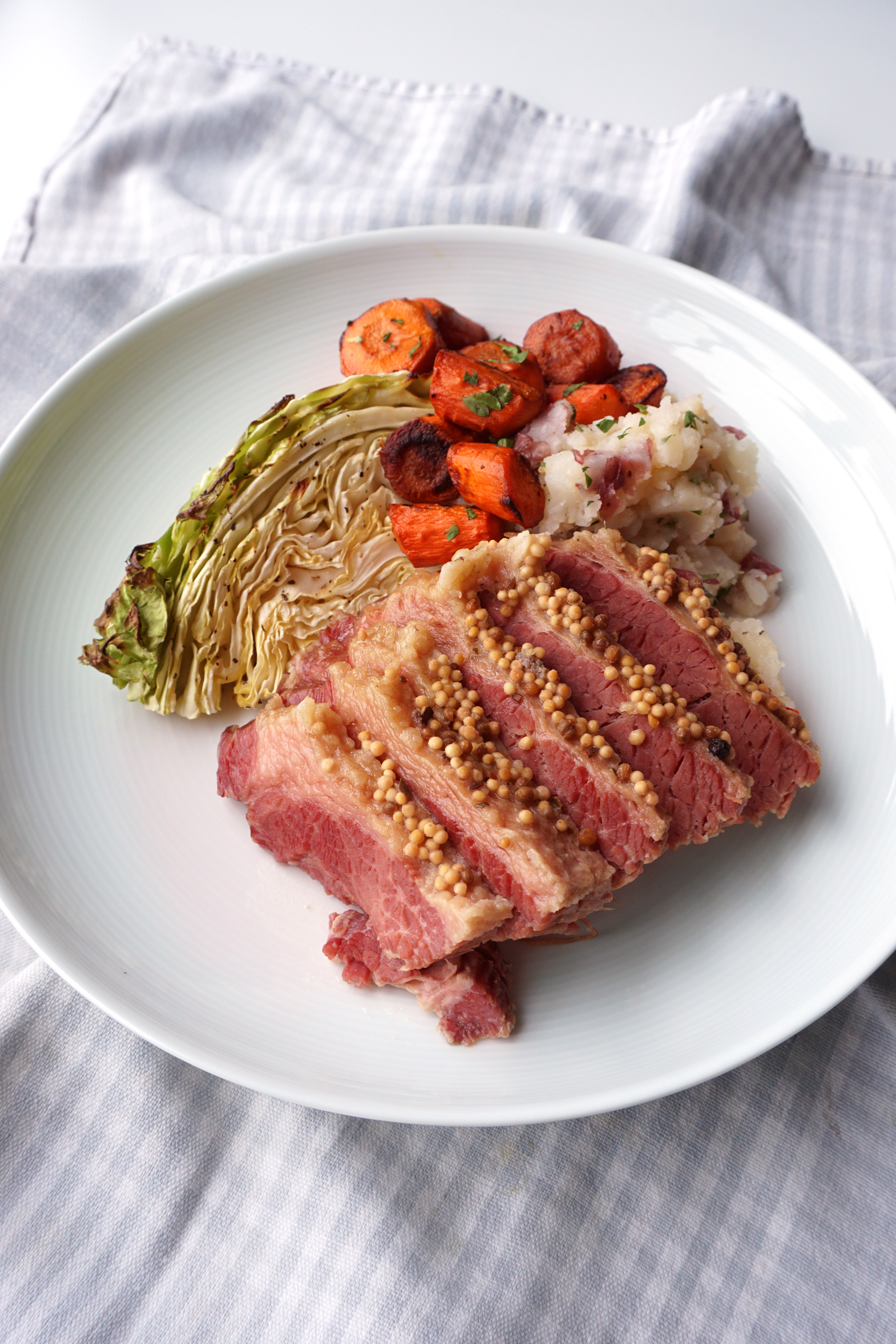 Corned Beef with Roasted Cabbage, Balsamic Carrots & Mashed Red Potatoes
