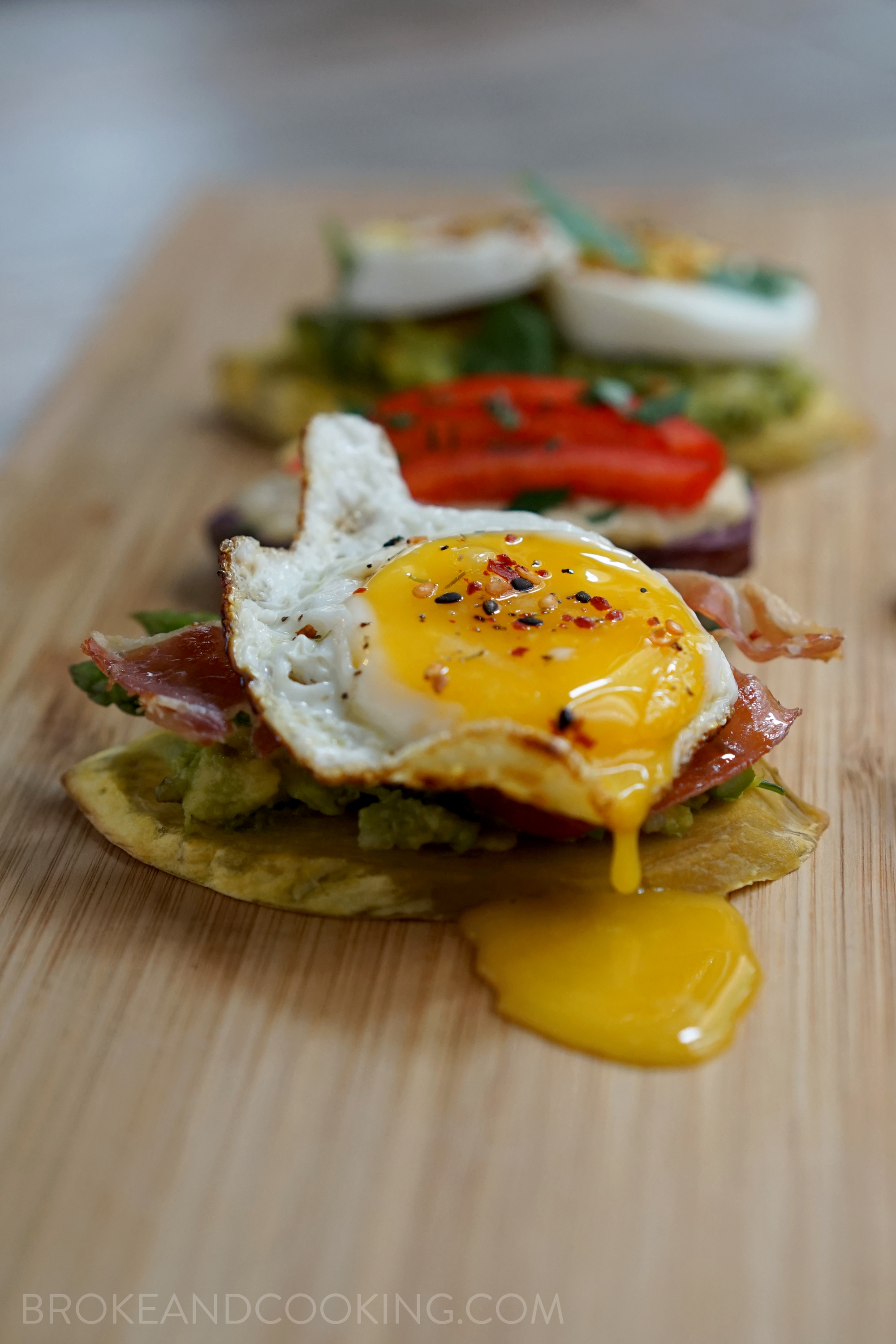 Sweet Potato Toast with Smashed Avocado, Sautéed Asparagus, Crispy Prosciutto, and Egg