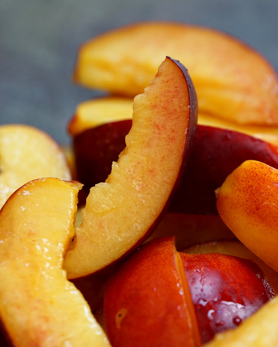 Wash, core, and slice the nectarines