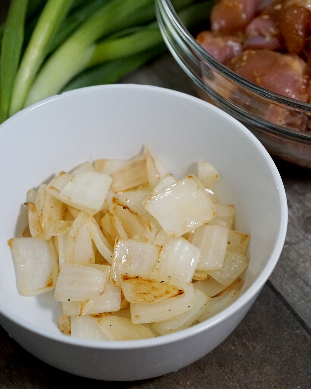 "Chop the onions into 1/2"" pieces. Heat a large pan over medium heat. Saute the onions in olive oil, seasoning with salt and pepper until almost translucent. Remove from the pan and place aside."