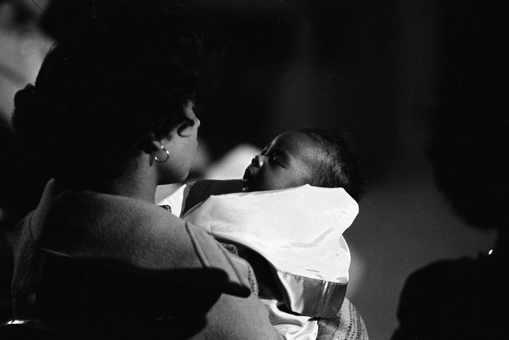 Mother and baby at NAACP meeting to discuss the missing and murdered children.  Photograph by Louie Favorite (1980  ) Atlanta Journal-Constitution Photographic Archives. Special Collections and Archives, Georgia State University Library.