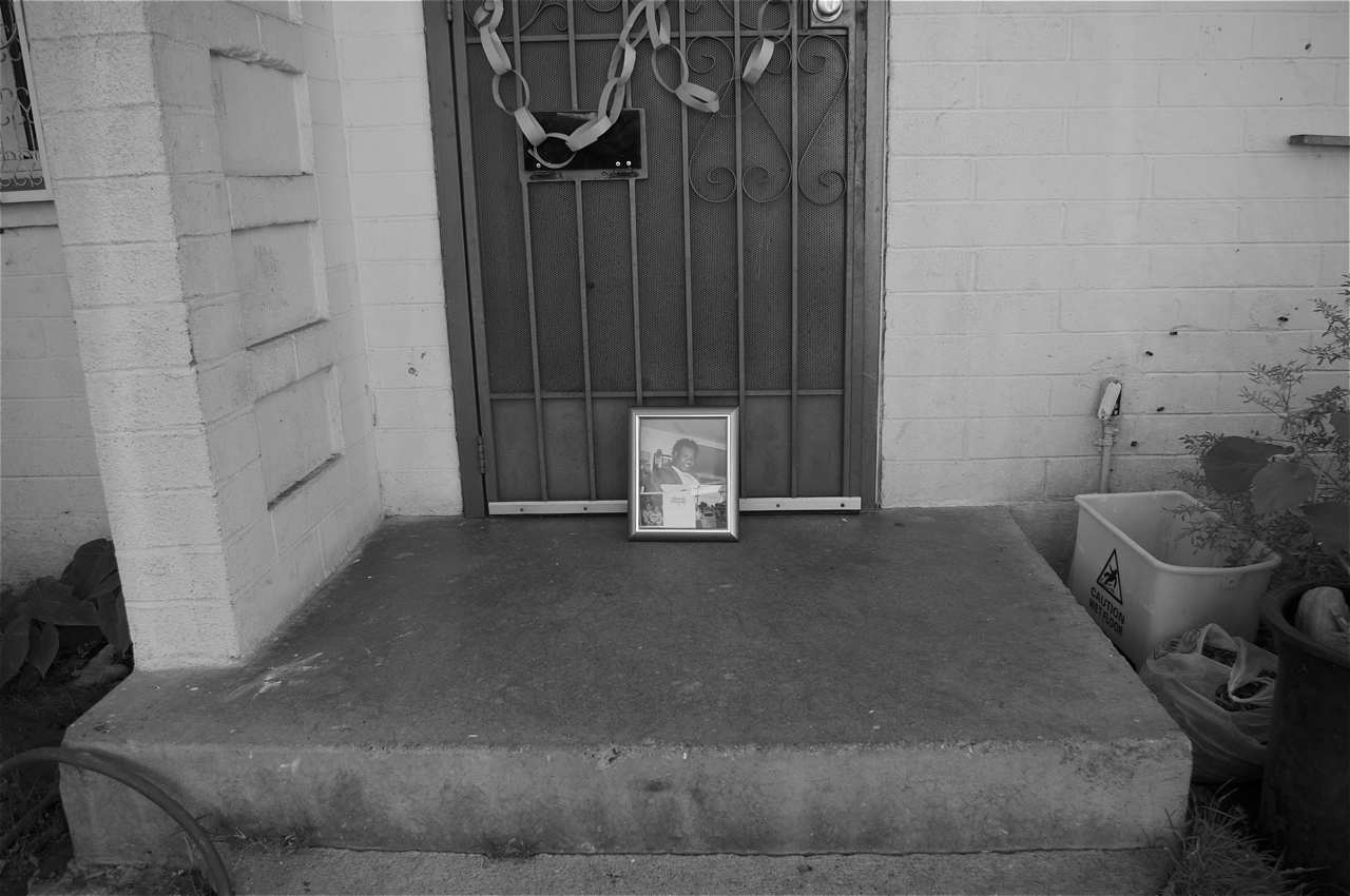 The front step where Maurio was shot in 2008. Sherika says she found him slumped over, halfway off the porch and partially in the bushes.  Sahra Sulaiman/LA Streetsblog  - View more of Sherika's story  here  .