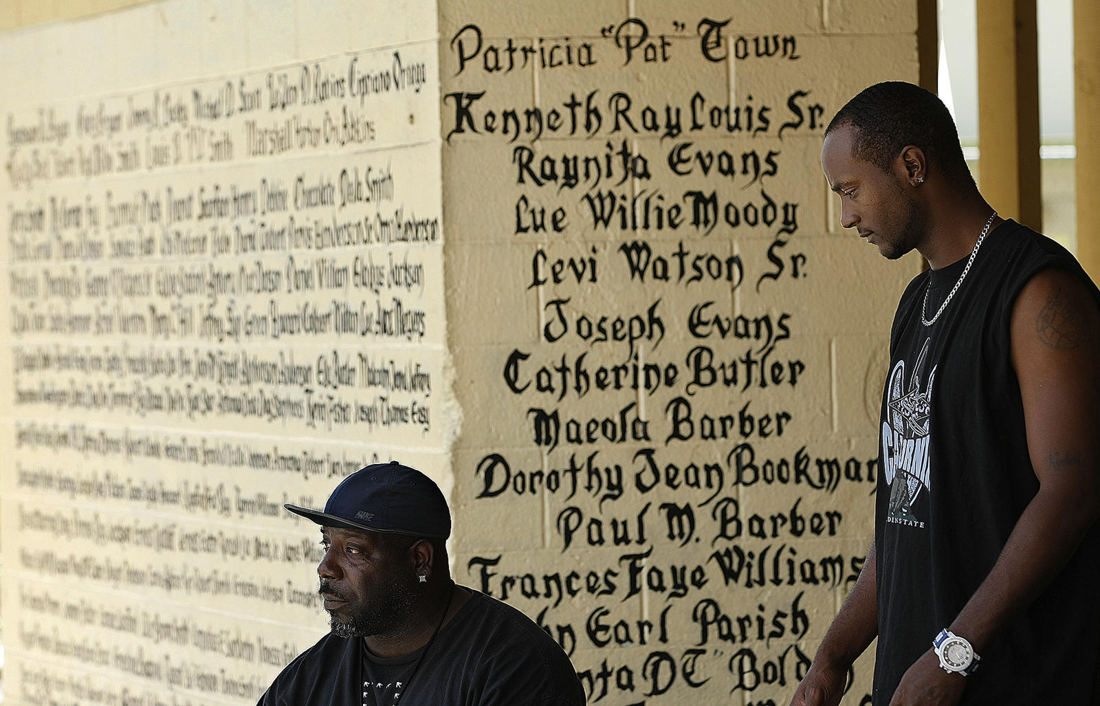 Eddie Williams, 44, left, and Louis Smith, 31, at 'the wall' L.A. Times