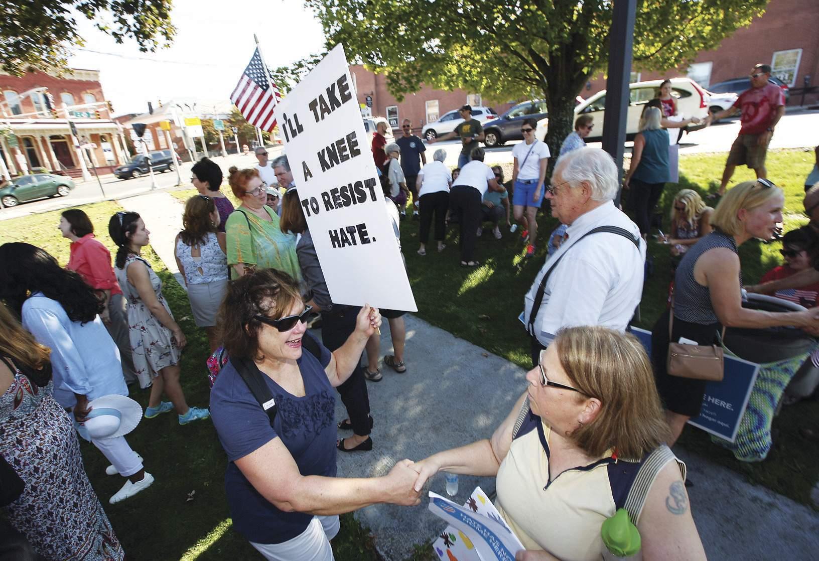Ann Pompelio knee to resist hate.jpg