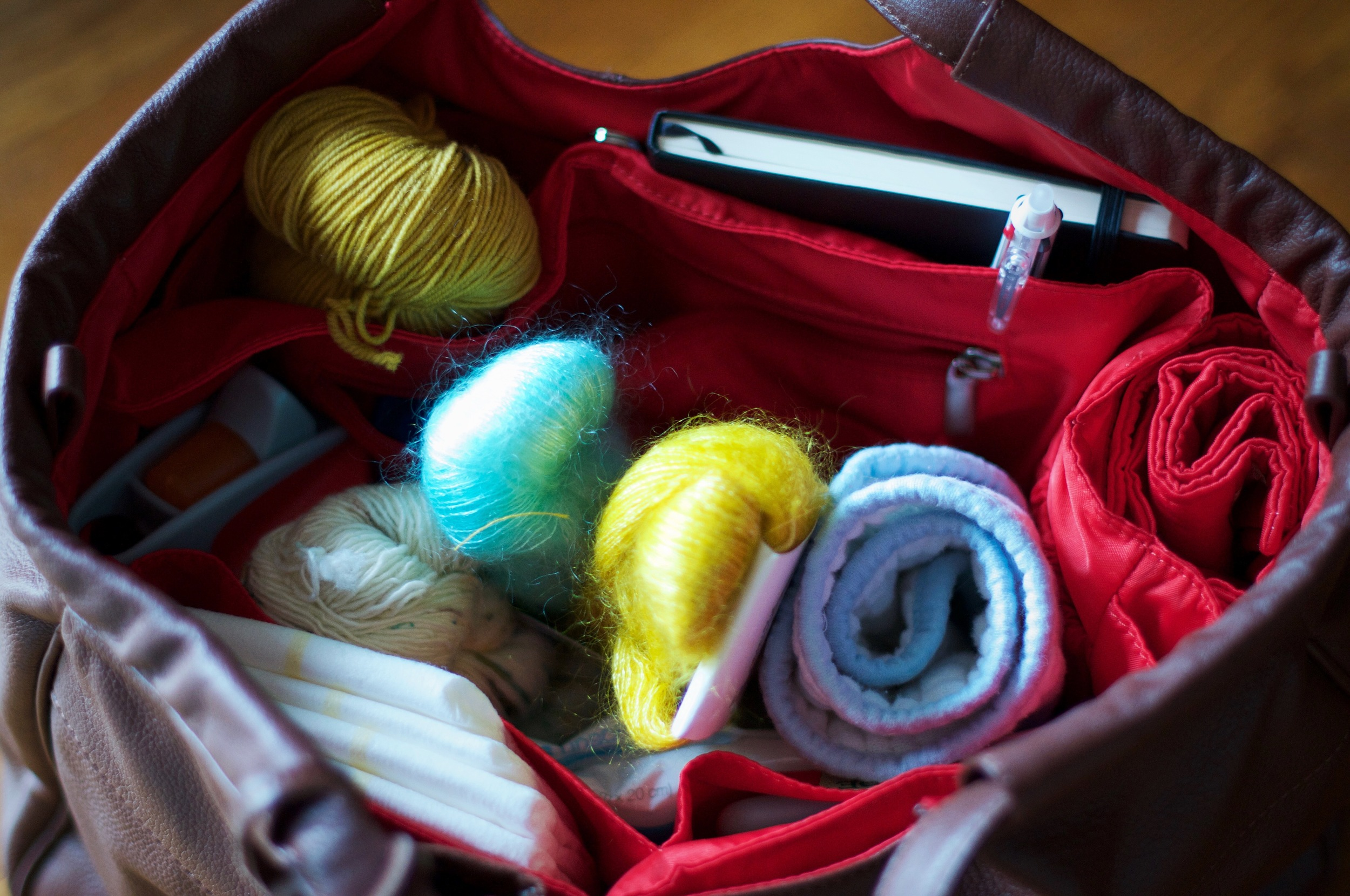 Why yes, that is my yarn and sketchbook snuggled up with diapers, sippy cup and burp cloth - necessities whenever we leave the house!