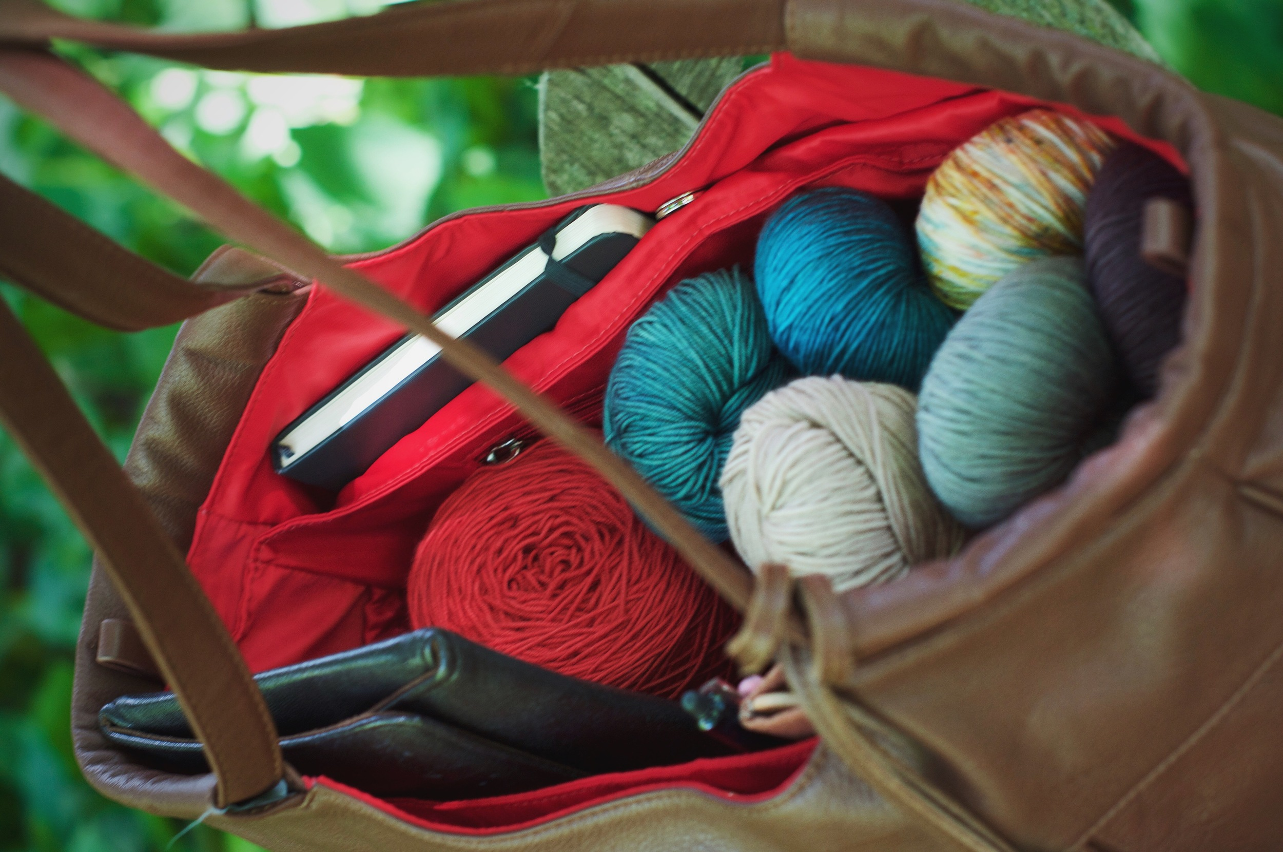 On those rare and wonderful occasions that I get to sneak off and knit sans babies ;), here she is, filled to the brim with my latest yarn haul, interchangeable needles, and sketchbook, inspiration sparked and ready to go!