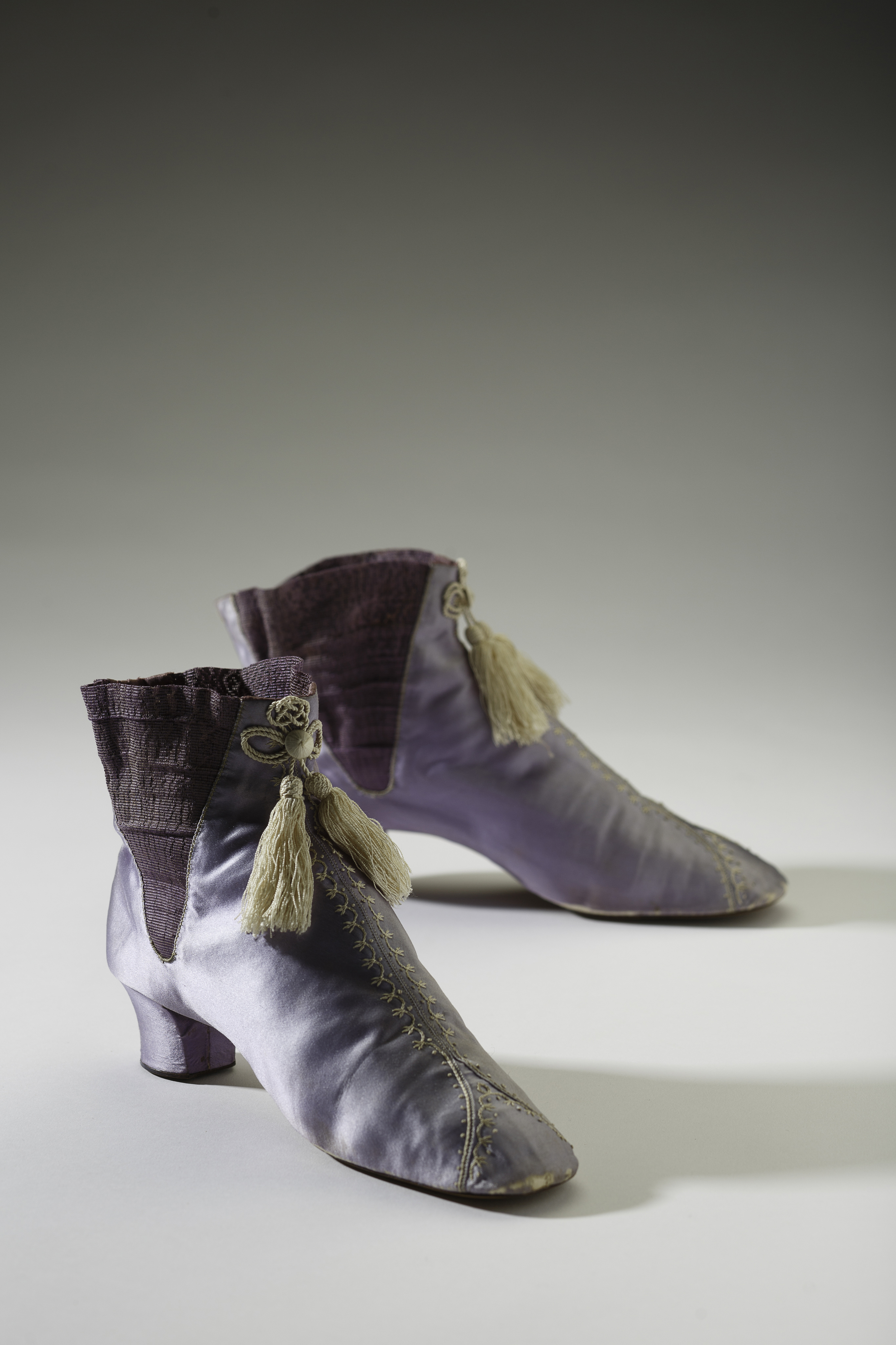 English, c.1860s . In 1856 when William Henry Perkins accidentally invented mauve, the first synthetic dye, a new age of colour in fashion was born. Soon vibrant and often gaudy synthetic colours were the toast of fashion, but many of these hues also came with risk to the wearer. Arsenic and picric acid were just some of the toxic chemicals used in create coloured clothing. Image © 2013 Bata Shoe Museum, Toronto, Canada