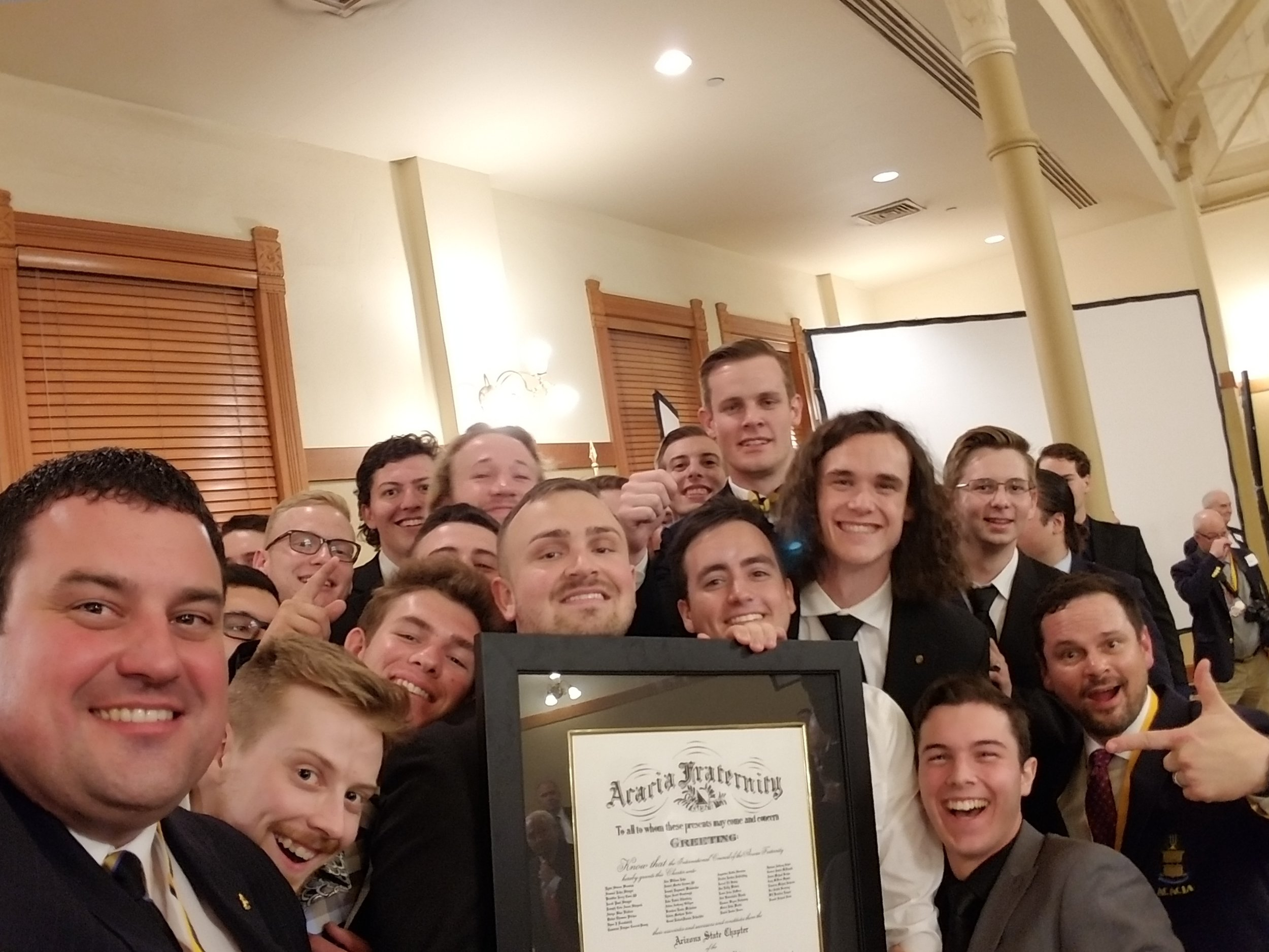 Arizona State members holding their charter with International President Jeremy Davis, Executive Director Patrick McGovern, and Director of Expansion and Recruitment Jerod Miles.
