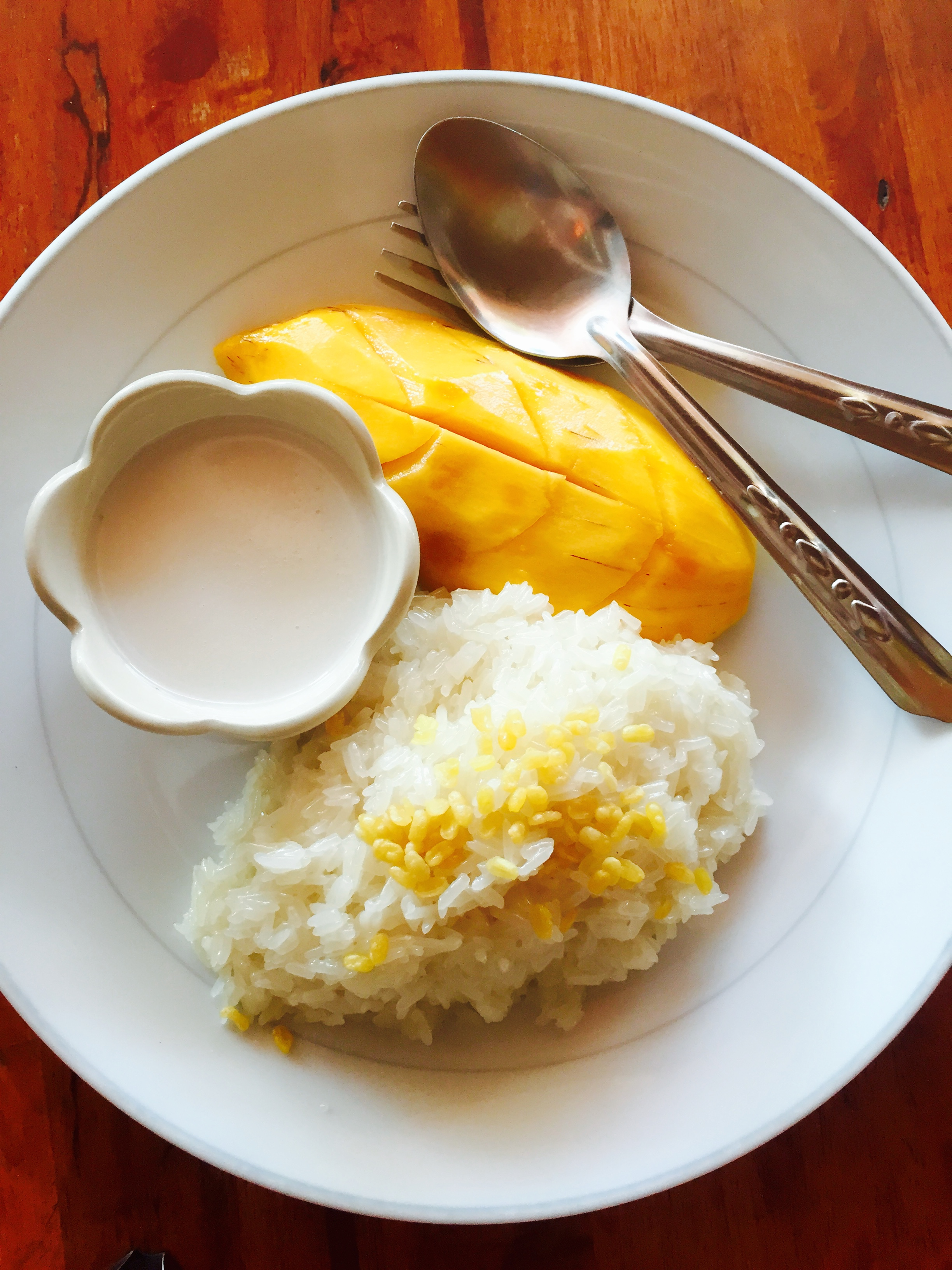 The BEST mango and sticky rice I've ever had. So beautifully presented, too!