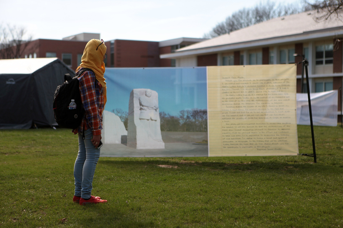 Photos requested by prisoners printed alongside their letters and displayed in George Mason University's public square.