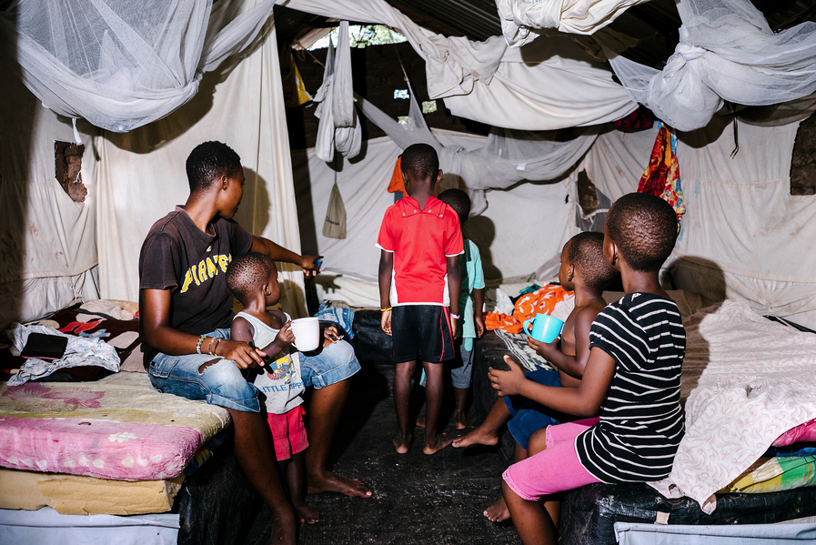 S., a lesbian refugee from Uganda, lives in a protected compound in the Kakuma Refugee Camp in Kenya with dozens of other LGBT refugees. A few of the women in the compound have children, and here, all six kids stand in one of mud-hut homes the refugees share.