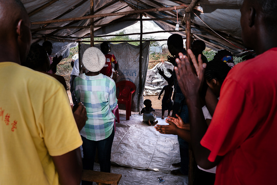 LGBT refugees attend a church service in one of their compounds. They have been kicked out of or barred from other church services in the area, but most of the LGBT refugees are deeply religious. One of the Ugandan refugees in the group was an Anglican minister in Kampala and he leads the group's service each Sunday.