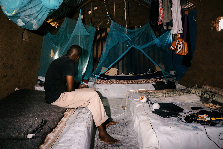 B., a gay refugee from Uganda, poses for a portrait in the mud-hut he shared with four others in the Kakuma. He fled violence and persecution in Uganda nearly a year and a half ago. He has since been resettled in the United States.