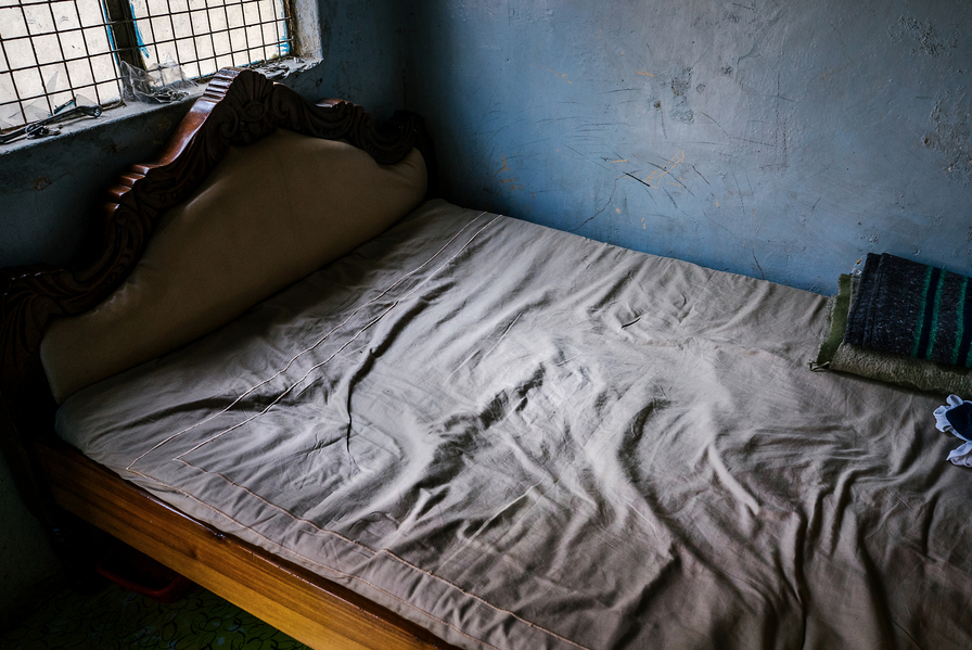 The bed a gay Congolese refugee shares with three straight friends. He moved in to this apartment after he was attacked and chased out of the previous apartment he lived in by his landlord and a gang of thugs. His bedmates don't know he is gay and he lives in constant fear of being discovered.