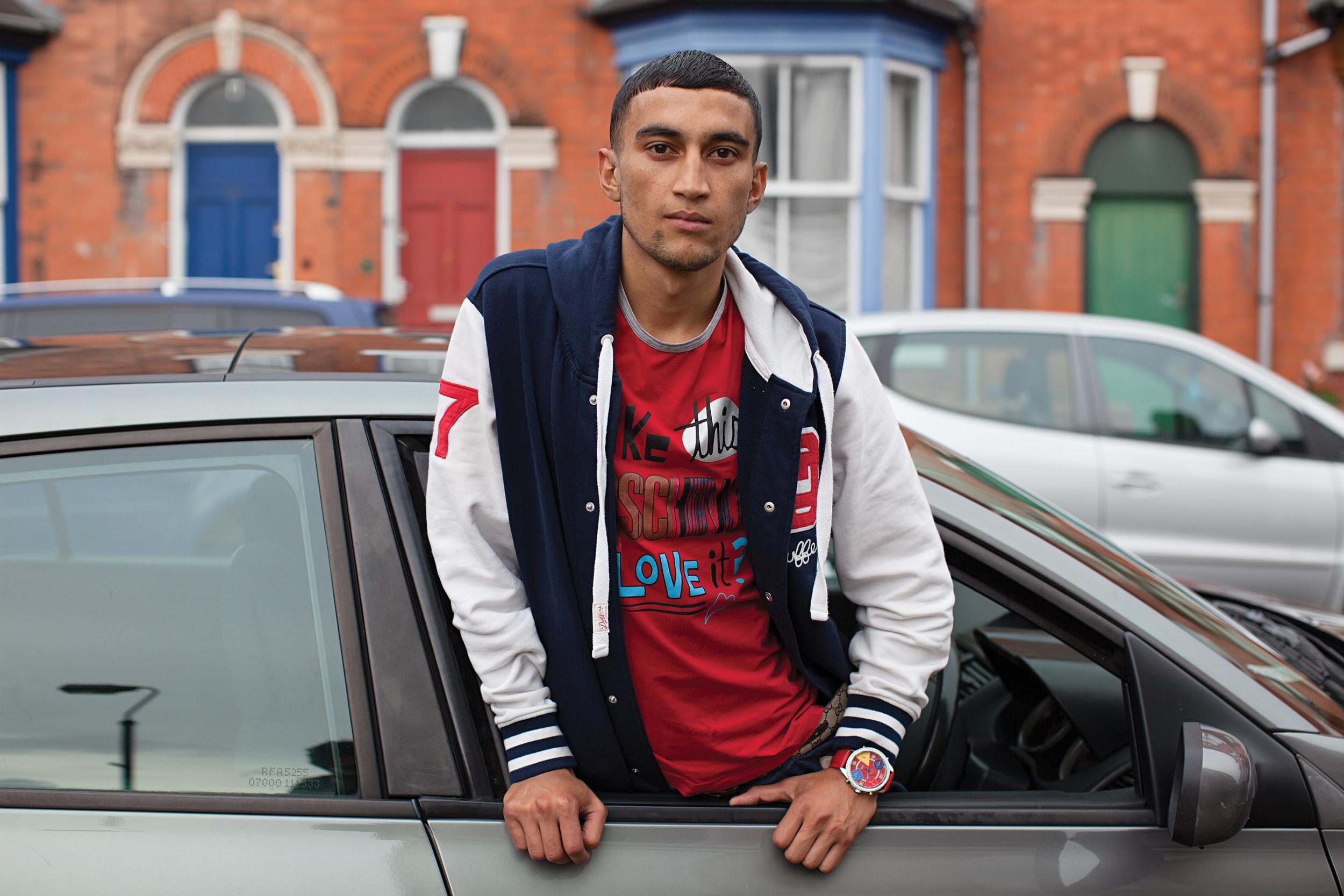 Red T-Shirt, baseball jacket, car © Mahtab Hussain - You Get Me?.jpg