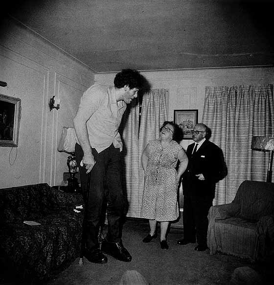 Arbus, Diane. (1970).  A Jewish Giant at Home With His Parents in the Bronx
