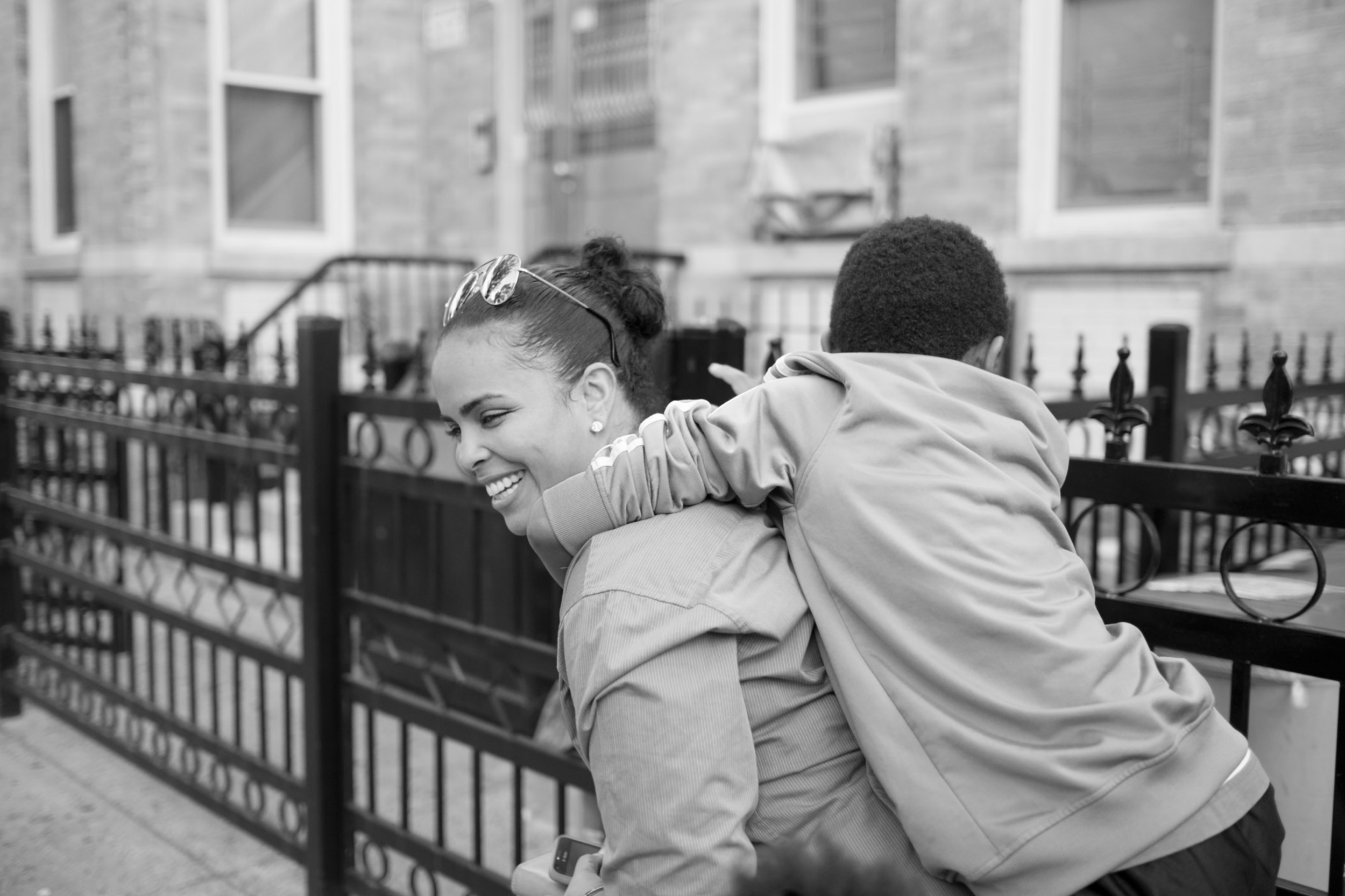 "Evelyn, who served 17 years, with the son of her domestic partner. Long Island City, NY (2014)   ""I met my partner when I'd only been home for a few days. She has three kids and me not having kids, I became close to the kids and that was an extra."""