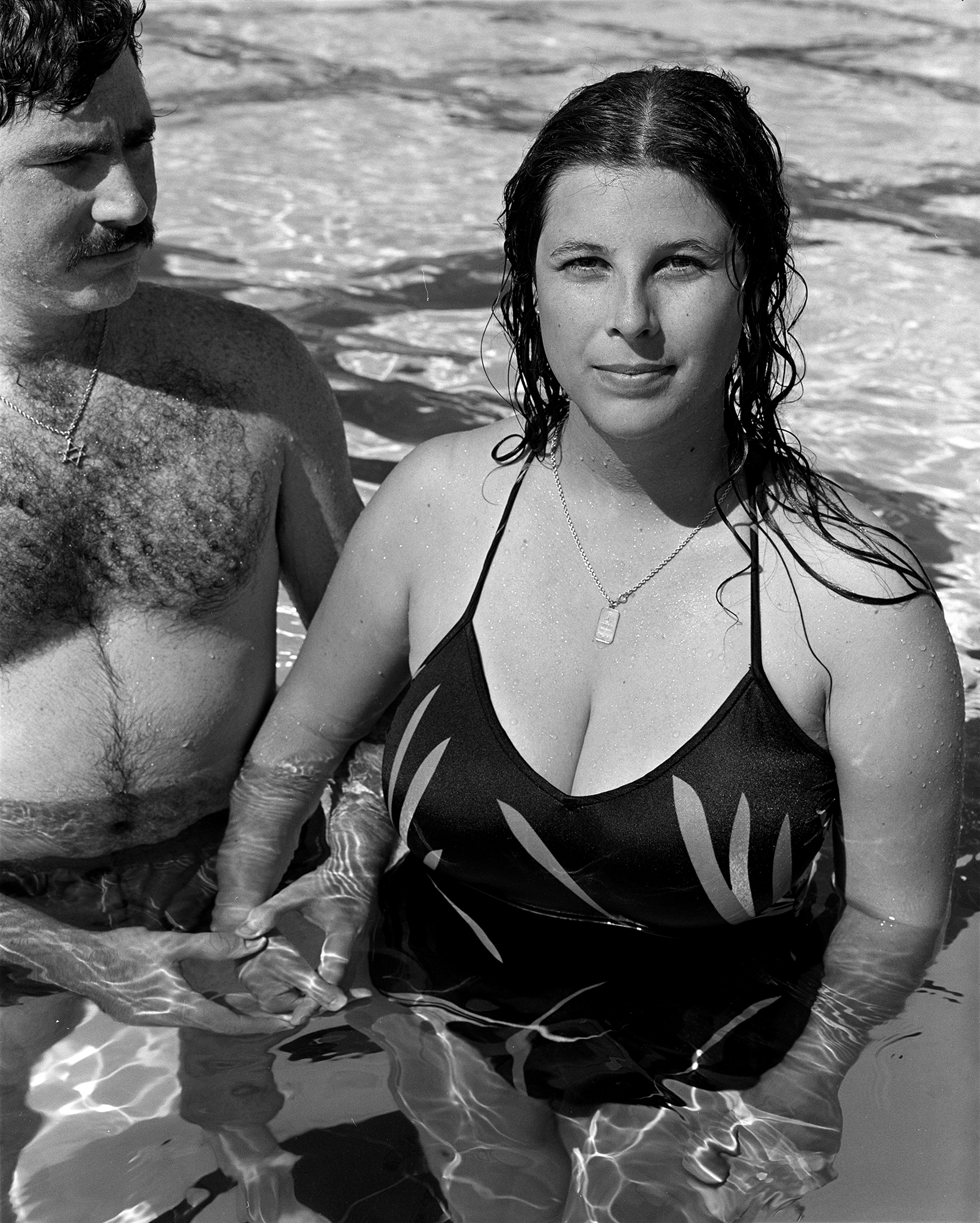 Woman with husband, JCC pool, 1981