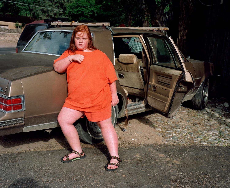 Girl by the car at the Tesuque Market, Santa Fe, 1996